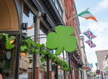 Exterior of irish pub decorated with shamrocks for St Patricks D. Outside street view of irish pub decorated with shamrocks for St Patricks Day Royalty Free Stock Photo