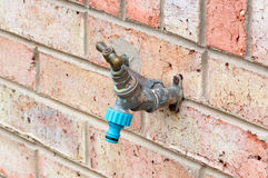 Outside Tap on a Brick Wall Stock Photo
