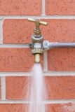 Outside tap on brick wall Royalty Free Stock Photography