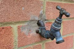 Outside tap. An outside tap fixed to a brickwall Royalty Free Stock Photo