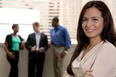 Outside team with female. Diverse team with female brunette leader Royalty Free Stock Photo