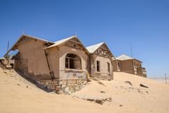 Outside view of one of the abandoned houses in the ghost town of Kolmanskop near Lüderitz in Namibia. Africa. After the diamond rush ended, the houses are royalty free stock photo