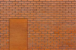 Brick wall with door. Outside view a a red brick wall with rusty door Stock Photos