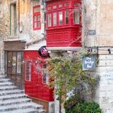 Outside view on the red colored bridge bar on Valetta, Malta near the harbour royalty free stock image
