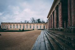 Outside view on the residence of Marie Antoinette in the gardens of Versailles. Versailles, France - January 2018: Outside view on the residence from Marie Royalty Free Stock Image