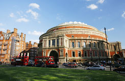 Outside view of Royal Albert Hall on sunny day. London, UK - May 26, 2013 : Outside view of Royal Albert Hall with green field, people and cars present on the Stock Images