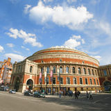 Outside view of Royal Albert Hall on sunny day. London, UK - May 26, 2013 : Outside view of Royal Albert Hall, people and cars present on the street. Royal Royalty Free Stock Images