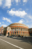 Outside view of Royal Albert Hall on sunny day. London, UK - May 26, 2013 : Outside view of Royal Albert Hall, people and cars present on the street. Royal Stock Photos