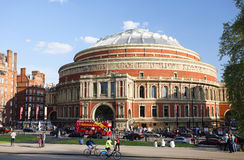 Outside view of Royal Albert Hall on sunny day. London, UK - May 26, 2013 : Outside view of Royal Albert Hall, people and cars present on the street and a Royalty Free Stock Photography