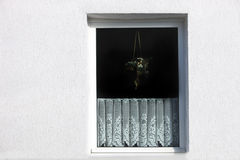 Window with decorative net curtain Royalty Free Stock Image
