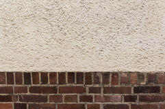 Outside wall, bricks plaster, textured background Royalty Free Stock Photography