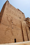 Outside wall at Edfu Temple in Egypt. Outside wall with hieroglyphs at Edfu Temple in Egypt Stock Photo