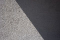Outside wall, gray plaster texture, shadow Stock Photos
