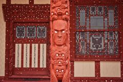 Outside wall of Maori church in Rotorua in New Zealand. Sightseeing of North Island of New Zealand, taditional carving, maori indigenous culture, tribal hand stock photo
