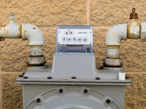 Outside wall natural gas meter dial display detail. Residential natural gas meter on exterior wall to measure household energy consumption shows reading on dial Royalty Free Stock Photo