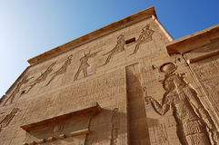 Outside wall at Philae Temple, Egypt. Dramatic view of an outside wall at Philae Temple in Egypt Royalty Free Stock Images