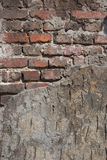 Outside wall, plaster and bricks Stock Images
