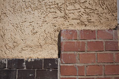 Outside wall, plaster and bricks Royalty Free Stock Images