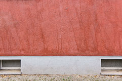 Outside wall with red colored ornate plaster, texture background Stock Image