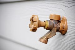 Outside water spigot Stock Images