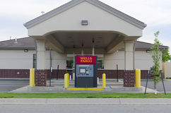 Outside Of Wells Fargo Bank And ATM Drive Through. Moorhead, Minnesota, United States - June 19th, 2015: Exterior of a Wells Fargo drive-through bank, with an Royalty Free Stock Photo