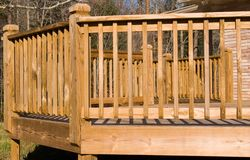 Outside of a wood deck. A photo to show the outside angles of a wooden deck. Useful to homebuilders and landscape planners royalty free stock image
