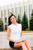 Outside work. Business woman with flowing hair Royalty Free Stock Image