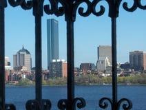 Outside world. Aerial view of Boston skyline through a balcony railing Stock Photos
