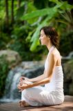 Outside Yoga. A young woman practising yoga outside royalty free stock photos