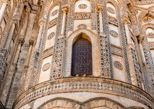 The outsides of the principal doorways and their pointed arches of the ancient Cathedral Church in Monreale, Sicily royalty free stock photo