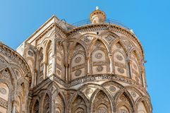 The outsides of the principal doorways and their pointed arches of the ancient Cathedral Church in Monreale, Sicily royalty free stock image