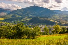 Outskirts of Carpathian town Volovets. Lovely countryside scenery in mountainous area with forested hills and cloudy sky Royalty Free Stock Image