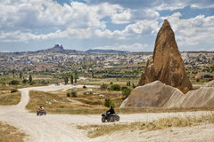 Outskirts Goreme Uchisar backdrop Quad dirt riders Royalty Free Stock Photography