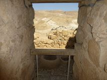 Masada fortress loophole in the Judean desert on the mountain. The outskirts of the Judean desert. Masada fortress loophole. Mountains and canyons in the Middle royalty free stock image