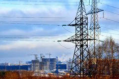 In the center of the picture we see the supports of high-voltage power lines, modern houses, roads, construction of buildings. In. Outskirts of Moscow.In the stock photo