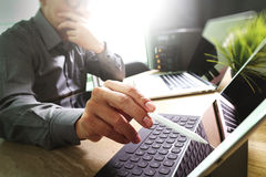 Outsource Developer working on marble Desk Working Laptop Comput Stock Photos