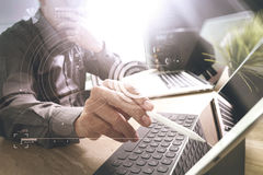 Outsource Developer working on marble Desk Working Laptop Comput Stock Photo