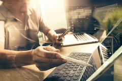 Outsource Developer working on marble Desk Working Laptop Comput Royalty Free Stock Images
