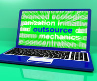 Outsource Laptop Shows Subcontracting Outsourcing And Freelance Royalty Free Stock Photography
