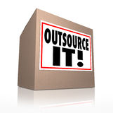 Outsource It Words Cardboard Box Shipping Jobs Labor Workforce. Outsource It words on a cardboard box label to illustrate shipping or moving jobs, production or Royalty Free Stock Photography