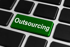 Outsourcing button on keyboard Royalty Free Stock Photos