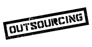 Outsourcing rubber stamp Stock Photo