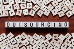 Outsourcing word concept stock photography