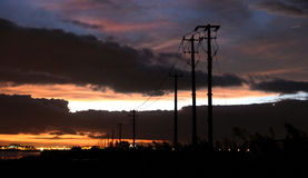 Outspread poles under magnificent and colourful sunset. Yellow, pink, purple and blue cloud. Poles spread out one by one Stock Photo