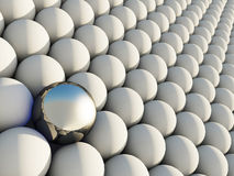 Outstanding. Big metallic sphere among smaller white spheres. Concept of outstanding individual Stock Images