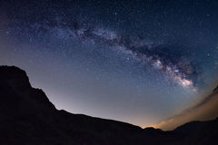 The outstanding beauty of the Milky Way arc and the starry sky captured at high altitude in summertime on the Italian Alps, Torino. Province. Fisheye scenic Stock Photography