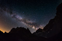 The outstanding beauty of the Milky Way arc and the starry sky captured at high altitude in summertime on the Italian Alps, Torino. Province. Fisheye scenic Royalty Free Stock Photos