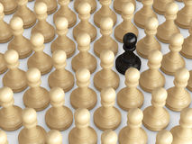 Outstanding Concept. Black pawn standing out from the crowd, brown chess pieces Stock Image