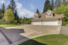 Outstanding country residence with a garage. Outstanding country residence with view of a garage, driveway and perfect landscape design stock images