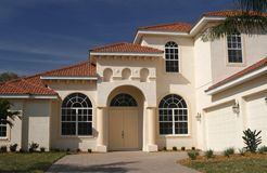 Outstanding new home with gables. Beautiful new home in tropics with layers of Stock Photos